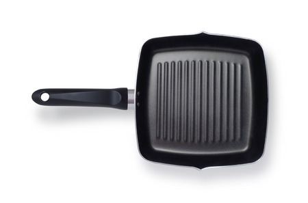non stick: Griddle frying pan shot from above isolated on white background with clipping path