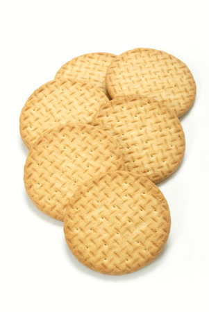 tea and biscuits: A group of plain tea biscuits on white