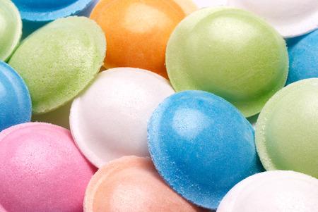 sherbet: Closeup of colourful flying saucer sherbet sweets. Rice paper encloses sherbet powder.