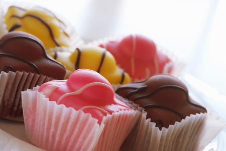 french fancy: Closeup of a selection of French fancies. Narrow depth of focus