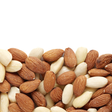 nutriment: Mixed almond nuts scattered on white