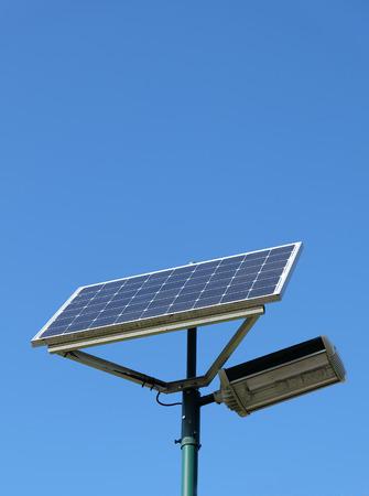 powered: Solar powered street lamp against clear blue sky Stock Photo