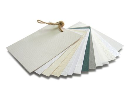 polygraph: Paper catalogue with samples with various textures. Isolated on white. Clipping path