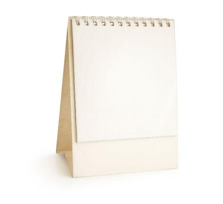 calendario escritorio: Calendario de escritorio - pir�mide, atascamiento espiral, en blanco. Aislado en blanco, trayectoria Foto de archivo