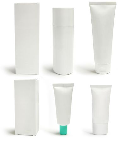 Cosmetics packs and containers: tubes, boxes, sprayers. Add text or label. Isolated, shadow Stock Photo