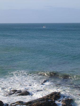 White boat in the ocean photo