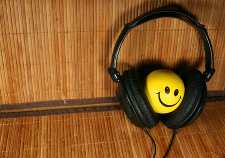 Smiling face and the headphones Stock Photo