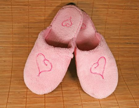 Pink slippers with a hert sign Stock Photo