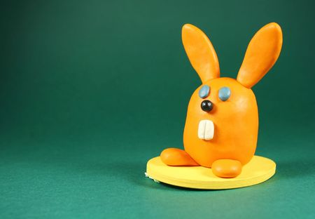 Orange rabbit on green. Made from plasticine Stock Photo - 796119