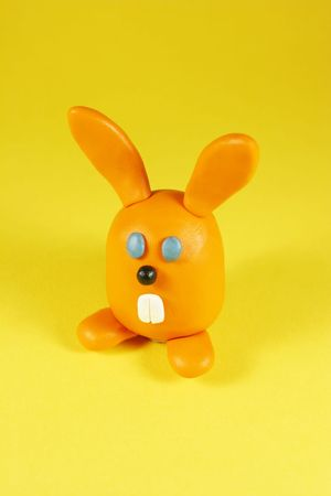 Orange rabbit on yellow. Made from plasticine Stock Photo - 804799