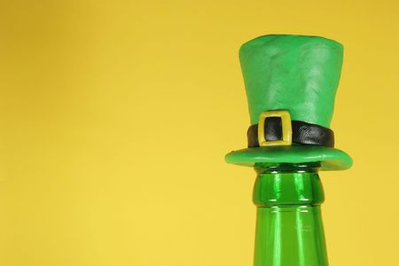 Beer bottle with a funny cork (St. Patrick s day style) photo