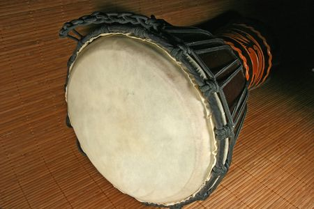 Photo of an african djembe drum on a bamboo background