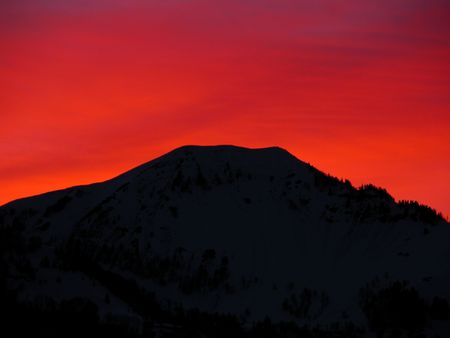 Red Sunset Over a Swiss Mountain photo