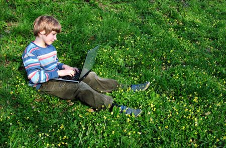 Browser. Child with notebook sit green grass (raw,tiff version of this image is available - contact me) Stock Photo - 399452