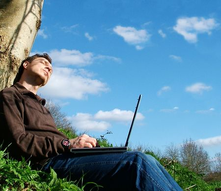 man with notebook sit blue sky,emotion, (raw,tiff version of this image is available - contact me) photo