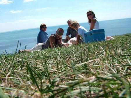 fatherhood: Family on a grass under the blue sky