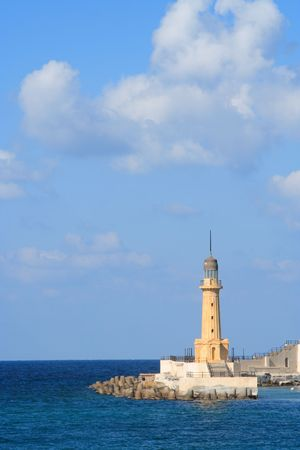 alexandria egypt: A lighthouse with large sky area and some clouds. This lighthouse is in Alexandria, Egypt Stock Photo