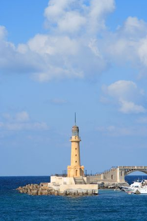alexandria: A lighthouse with large sky area and some clouds. This lighthouse is in Alexandria, Egypt Stock Photo