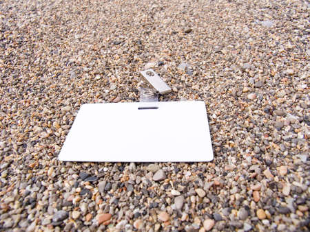 timecard: Badge on a beach from fine stones