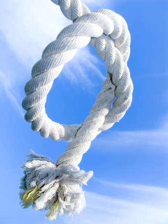 Unit from a rough cord on a background of the blue sky Stock Photo