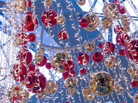 Celebratory Christmas ornament with spheres and multi-colored streamer photo