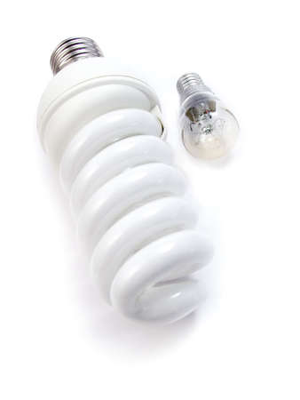 An energy efficient bulb and a small electric bulb. Isolated on a white background photo
