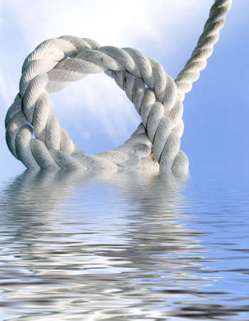 Double knot from a rough cord on a background of the blue sky. Reflection in water Stock Photo