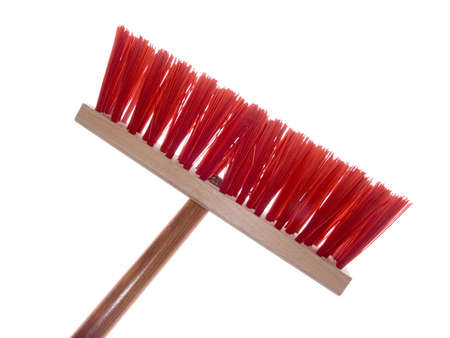 Wooden red brush for cleaning a floor isolated on a white background Stock Photo