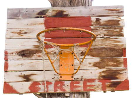Old basketball basket for street game on the big tree