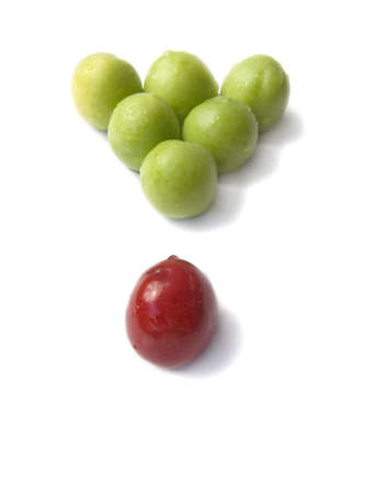 Figure of billiards from fruits of plums and sweet cherries it is isolated on a white background
