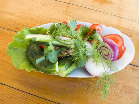 woodenrn: Appetizing vegetable salad from a tomato of a cucumber of an onions and greens