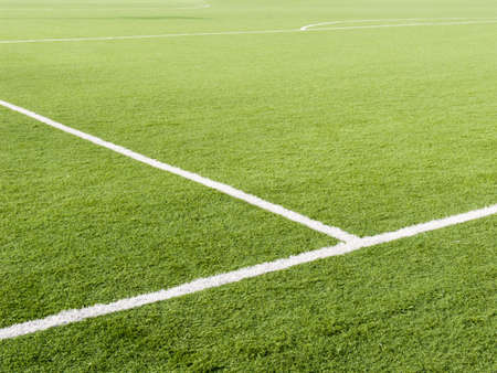 cricket field: Field for game in football with a green grass and white lines