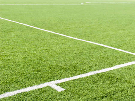 Field for game in football with a green grass and white lines