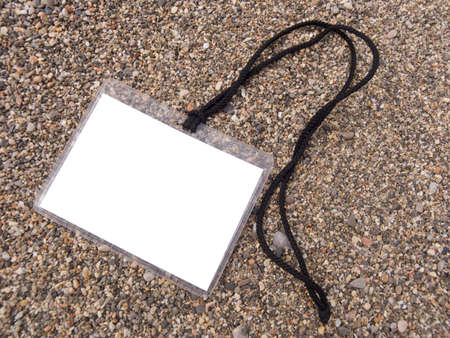 inquiring: White Badge On a cord on a background of a sea coast