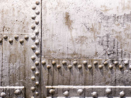 embossed: Surface of the old metal tank with rivets