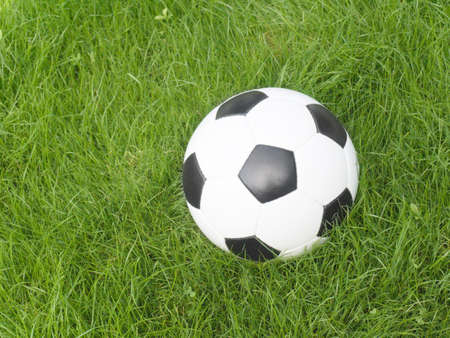 Soccer ball on a lawn from a green grass Stock Photo - 3225917