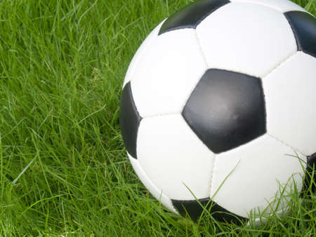 Soccer ball on a lawn from a green grass Stock Photo - 3225916