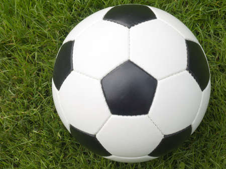 Soccer ball on a lawn from a green grass Stock Photo - 3262654