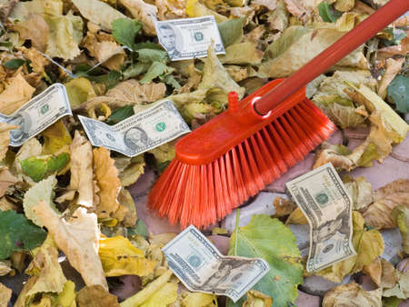The American dollars on a background of autumn leaves. Depreciation of currency. Crisis.