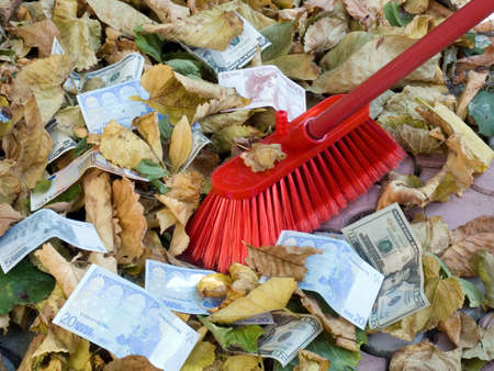 depreciation: The American dollars and euro on a background of autumn leaves. Depreciation of currency. Crisis