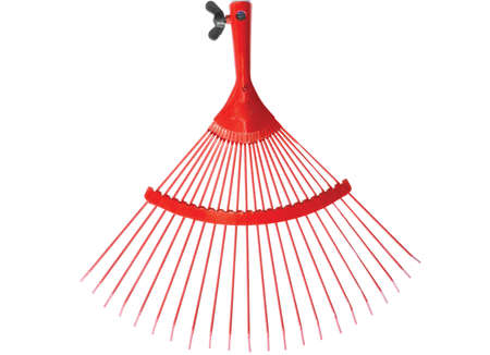 Red raker for cleaning a lawn Stock Photo