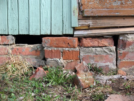 Destroyed Foundations Of Old Buildings In The Garden Stock Photo