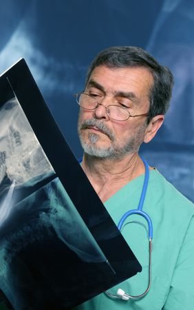 Medical Doctor with stethoscope reading Xray photo
