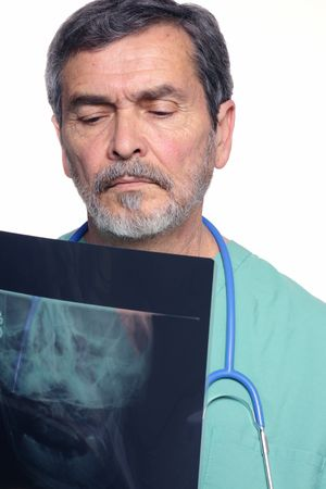Medical Doctor MD Surgeon reading x-ray photo