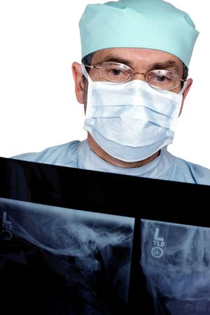 Medical Doctor MD Surgeonn reading x-ray photo