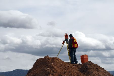 surveyor: Surveying on a Construction Site Stock Photo