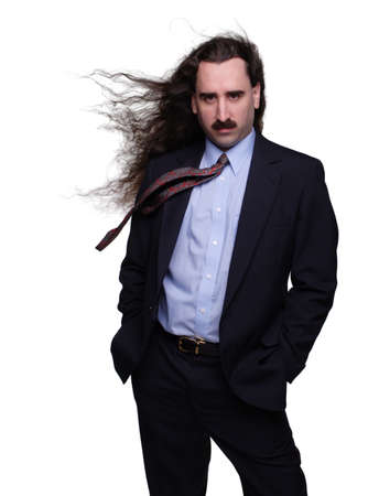 wind blown hair: Fashionable businessman with long wind blown hair 1