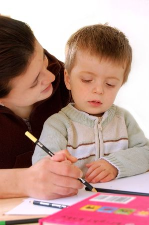 Mother and Son, child being taught to write.