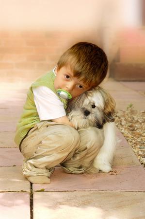 Boy cuddling his best friend Stock Photo