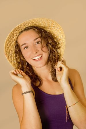 Beautiful brunette smiling holding her hat.  Stock Photo - 3708572